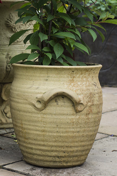 A smaller Greek style garden pot on the patio