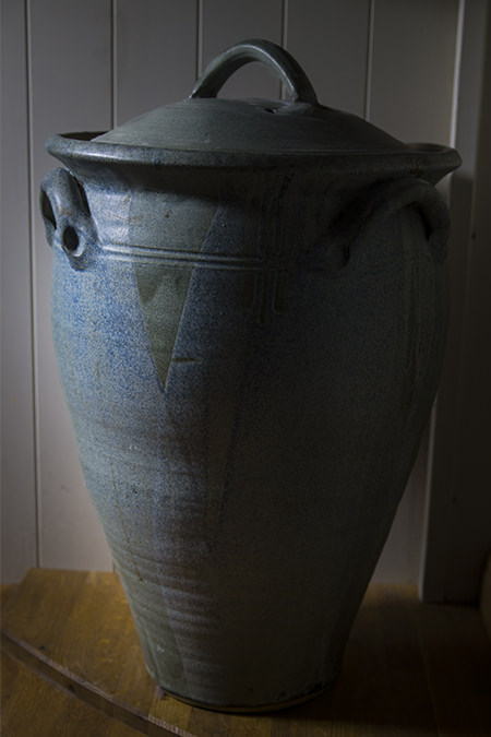 Tall elegant bread bin with Greek urn styling